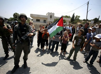 Palestinian children take part in a protest against the expansion of the Israeli settlements at Nabi Saleh village near the West Bank City of Ramallah.