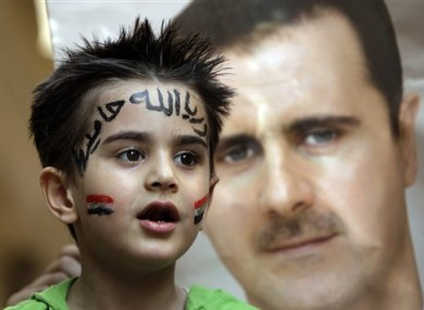 A Syrian boy, with writing on his forehead that reads