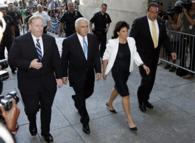 Former International Monetary Fund leader Dominique Strauss-Kahn arrives at New York Supreme court with his wife Anne Sinclair, Friday, July 1, 2011.