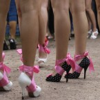 Participants in a high heel race wait for a start of a high heel race in Moscow, Russia, on 9 July, 2011. The