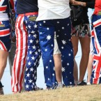 Spectators with colourful trousers follow USA's John Daly at the 2011 Open Championship at Royal St George's, Sandwich.