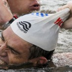 Greece's Spyros Gianniotis pulls off his cap after winning th men's 10km Open Water swimming event at the FINA Swimming World Championships at Jinshan Beach in Shanghai, China on 20 July. Gianniotis finished with a time of 1:54.24.7. (AP Photo/Ng Han Guan)