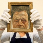 File photo dated 27/10/2010 of Sotheby's employee Chloe Stead holding 'Self Portrait with a Black Eye' by British artist Lucian Freud at Sotheby's auction house, London. (PA Image)