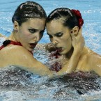Spain's Andrea Fuentes and Ora Carbonell compete in the synchronised swimming Duets Free final, at the FINA 2011 Swimming World Championships in Shanghai, China, on 22 July, 2011. (AP Photo/Wong Maye-E)