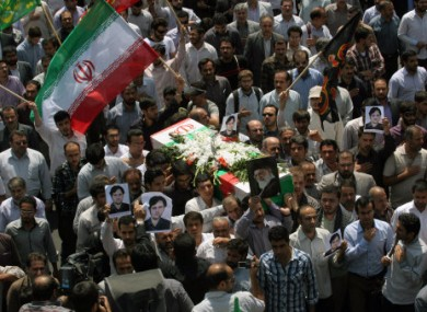 Iranians carry coffin of who was first reported to be Darioush Rezaeinejad, in a funeral ceremony, on Sunday, July 24, 2011.
