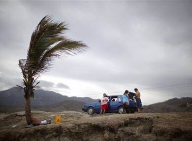 A family prepares to leave Miramar beach before the arrival of Tropical Storm Beatriz in Manzanillo, Mexico, last month.