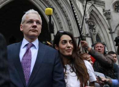 Wikileaks founder Julian Assange, left, leaves Britain's Royal Courts of Justice after his extradition appeal