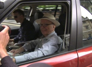 News Corp CEO Rupert Murdoch rolls down the window of the vehicle taking him to his apartment in St James's, central London to enable photographers to take pictures Sunday July 10, 2011.