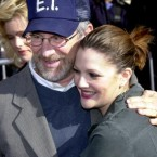 Drew Barrymore and godfather Steven Spielberg pose for the cameras. Drew's parents, grandparents and great-grandparents were all actors. At the age of 15 she sought, and won, emancipation from her parents in the courts, legally making her an independent adult.<span class=