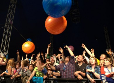 The crowd at Mitchelstown's Indiependence music festival in Co Cork play with giant bouncing balls during Ham Sandwich's set