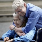 Phyllis Siegel, 76, left, and Connie Kopelov, 84, embrace after becoming the first same-sex couple to get married at the Manhattan City Clerk's office. (AP Photo/Jason DeCrow)