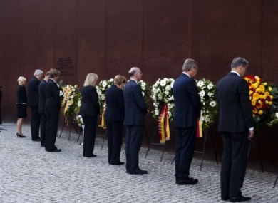 German officials attend a wreath laying ceremony at the commemoration of the 50th anniversary of the construction of the Berlin Wall.