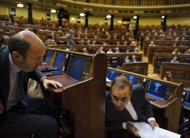 Socialist Party presidential candidate Alfredo Perez Rubalcaba, left, speaks with the socialist party spokesman for the parliament Jose Antonio Alonso during a extraordinary plenary session at the Spanish Parliament in Madrid, Tuesday Aug. 30, 2011.