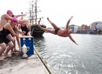 2010 Liffey Swim winner Brian O'Dwyer is pushed into the river during today's announcement of this year's race.