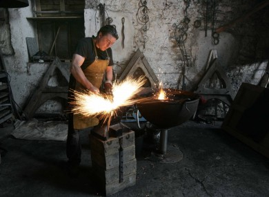 Blacksmith David Page demonstrates his skill in a Heritage Week event today.