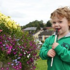 Two-and-a-half year-old Eoghan Gunn from Cavan attempts to play the tin whistle.