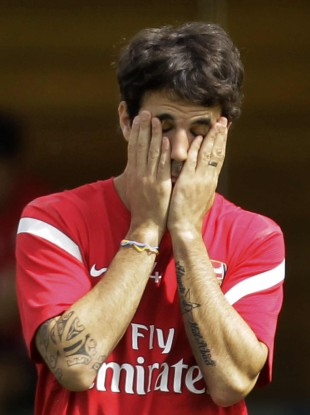Cesc looks about as tired of all this as we are.