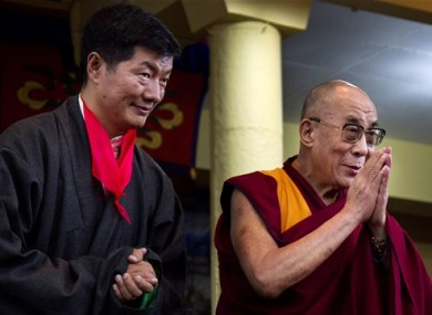 Lobsang Sangay, left, the new prime minister of Tibet's government in exile, stands next to Tibetan spiritual leader the Dalai Lama.