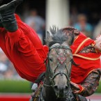A member of the Ukranian Cossack group perform horsemanship tricks in the main arena at the RDS Dublin. (Julien Behal/Photocall Ireland).