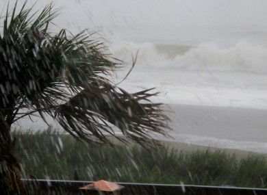 Rains and waves from Hurricane Irene batter the shore in downtown Myrtle Beach, South Carolina