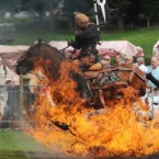 A member of the Rockin' Horse Equestrian Stunt Team rides his horse through flames as part of the Thornton-le-Dale Country Show near Pickering, North Yorkshire. (AP Photo/Anna Gowthorpe)