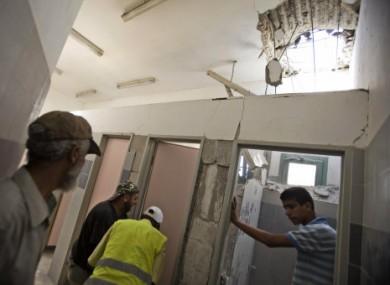 Israelis inspect damage to school hit by Palestinian militant attacks on southern Israel