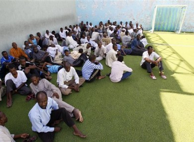 Men suspected of being mercenaries for Moammar Gadhafi, are held in a district sports center next to the medina, set up as provisory jail in Tripoli, Libya, Tuesday, Aug. 30, 2011.