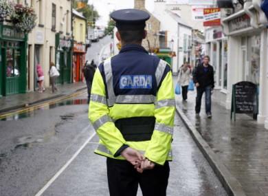 File photo: a garda patrols the streets of Cavan.