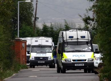 Police vans at the Greenacre caravan site in Leighton Buzzard this morning.