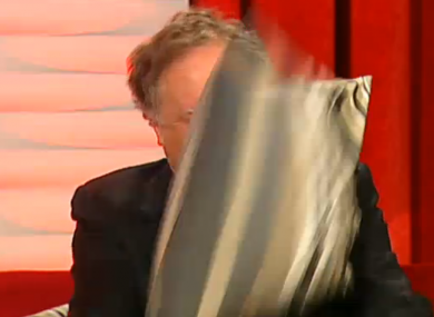 Vincent Browne takes cover from a cushion thrown by Jedward on the first edition of Friday Late with Vincent Browne.