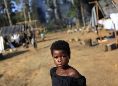 An Ivorian girl walks amongst tents in a camp housing more than 2,600 Ivorian refugees