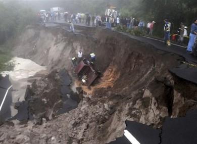 A landslide caused by heavy rains at the Pan American an highway La Cuesta de la Moramulca, 52 Km. from Tegucigalpa, Honduras, Monday, Oct. 17, 2011.