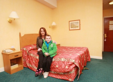 Niamh Ryan and her son Clyde, who turned 7 today, in the Regency Hotel in Dublin. They are being housed in the hotel after being told to evacuate their home at the Priory Hall apartment complex.