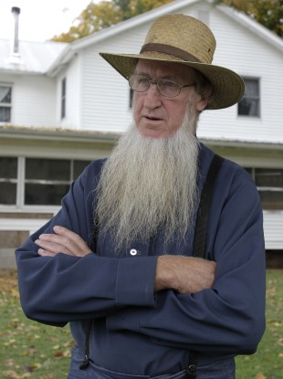 Outside his home in Bergholz, Ohio, Amishman Sam Mullet, father of two men arrested for allegedly going into the home of other Amish and cutting their hair and beards