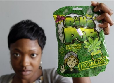 Felicia Williams, Community Liaison for Buffalo City Council member Darius Pridgen, holds a package of 'Ring Pots' sweets.