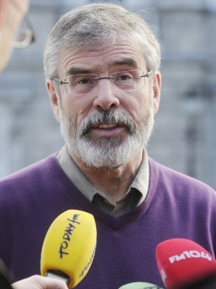 Gerry Adams gives the media his response to the Eurozone deal outside Leinster House in Dublin today.