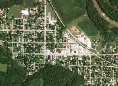 The small community of Tiskilwa, Illinois, seen from the air. The train derailed from the railway line visible looping from centre north to east of the picture.