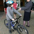 McAleese is pictured with 12-year-old Gavin Trueick on his bike during a European Child Obesity conference.