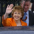 1 October 2004: President Mary McAleese waves to photographers as she leaves the Customs House in Dublin, after being returned unopposed as President of Ireland for a second seven year term.