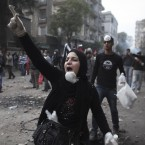 A protester gestures during clashes with Egyptian riot police in downtown Cairo today. (AP Photo/Tara Todras-Whitehill/PA Images)