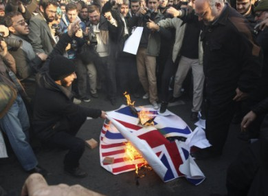 Iranian protesters burning foreign flags outside the British embassy in Tehran yesterday.