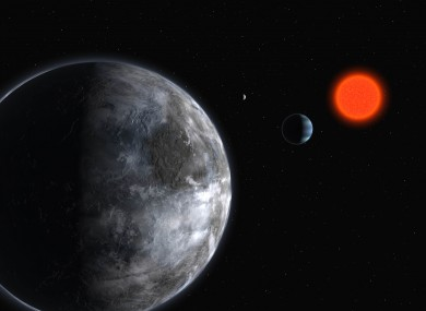 This artistic illustration released by the European Southern Observatory on Tuesday, April 24, 2007, shows planets orbiting the red dwarf star, Gliese 581.