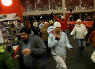 Shoppers rush into a shop at 4am on Black Friday in 2010 to ensure they pick up a bargain