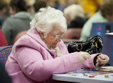 A woman playing bingo at Rock Bingo in Cork, before its closure