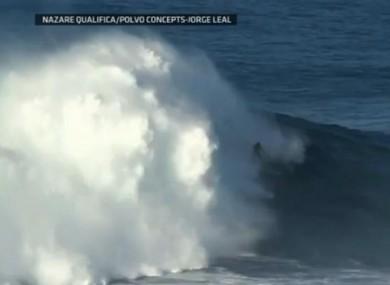 Surfer Garrett McNamara riding the mammoth wave in Portugal yesterday