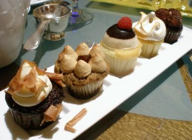 From left to right: Black Forest, Tiramisu, Boston Cream Pie, Lemon Meringue, and Irish Coffee Petite Cupcakes. DELICIOUS.