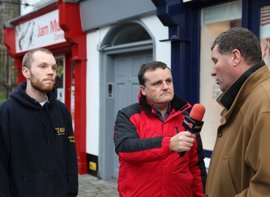Munnelly (L) debates with Lawlor (R) outside the TD's constituency office in Naas this afternoon
