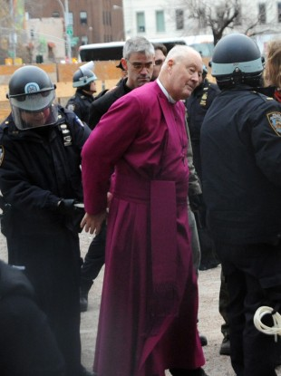 Retired Episcopal Bishop George Packard, middle, being arrested at an Occupy Wall Street demonstration in New York yesterday