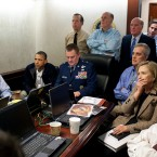 US President Barack Obama, Vice-President Joe Biden and Secretary of State Hillary Rodham Clinton react to live footage of US Navy Seals attacking bin Laden's compound in Pakistan on 1 May. (The White House/Flickr.com)
