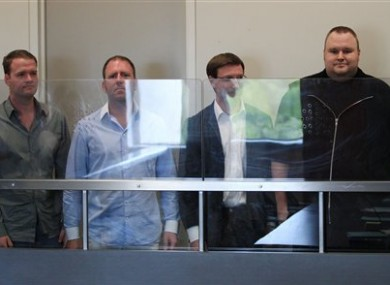 MegaUpload founder Kim Dotcom, far right with three of his employees in a New Zealand court.